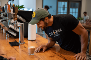 man looking at coffee | The Grind Roasters